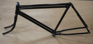 This is the frame of a very large tricycle with timber tray that we restored recently. These are very very solid frames built to carry heavy loads.