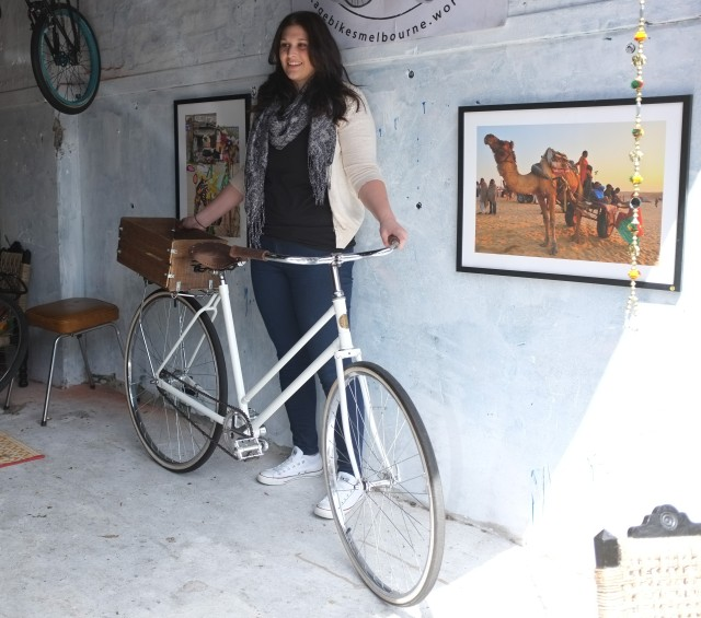 The owner of the Hercules project picks up her restored bike.