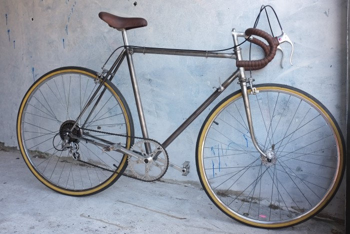 A vintage Legnano that we restored, was the gents fathers bike, raw metal coated in a rust prevention sealant, using a recovered seat and our Mottainai leather bar tape
