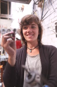 Our new(ish) mechanic, Coralie, giving away one of our secrets: steel wool. Don't tell anyone!