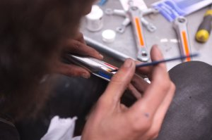 Painting the Dutch colours on a Campagnolo seat post for a Gazelle build (of course!)
